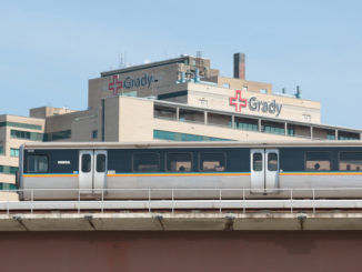 A MARTA train passes Grady Memorial Hospital in Atlanta in August 2014. (Photo by Todd DeFeo)