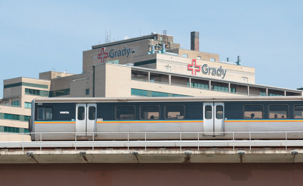 A MARTA train passes Grady Memorial Hospital in Atlanta in August 2014. (Photo by Todd DeFeo)