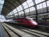 "(""Thalys Amsterdam Centraal"". Licensed under Public Domain via Wikimedia Commons - https://commons.wikimedia.org/wiki/File:Thalys_Amsterdam_Centraal.jpg#/media/File:Thalys_Amsterdam_Centraal.jpg)"