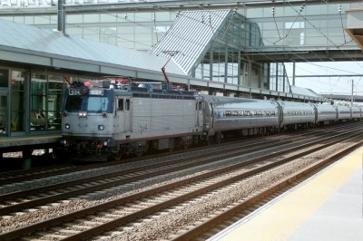 An Amtrak train, pulled by an AEM-7 electric locomotive, passes through the Newark Liberty International Airport trains station in Newark, N.J., in 2003.