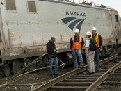 NTSB Recorder Specialist Cassandra Johnson works with officials on the scene of the Amtrak Train 188 Derailment in Philadelphia. (NTSB photo)